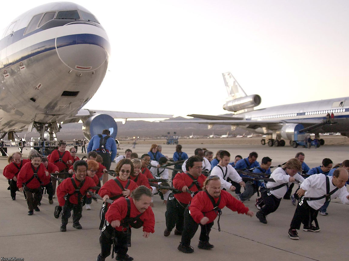 bunch_of_midgets_pulling_airplane