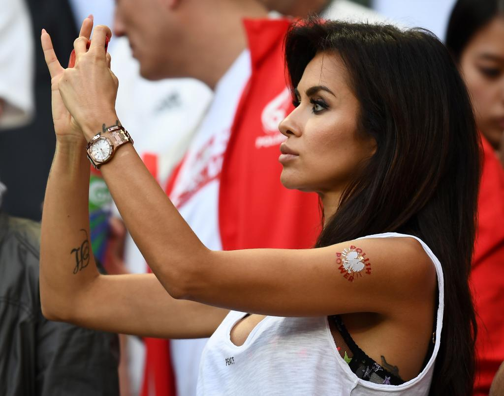 A Poland fan takes a photograph during the Euro 2016 group C football match between Germany and Poland at the Stade de France stadium in Saint-Denis near Paris on June 16, 2016. / AFP PHOTO / FRANCK FIFE