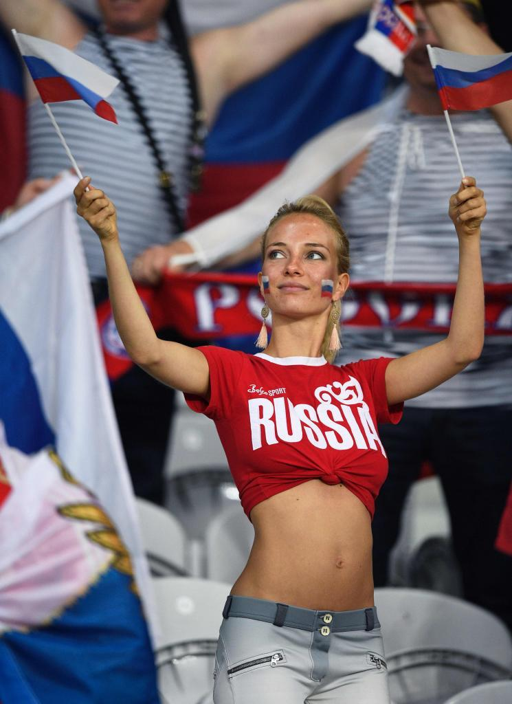 A Russia fan holds a Russian flag as he waits for the start of the match before the Euro 2016 group B football match between Russia and Slovakia at the Pierre-Mauroy stadium in Lille on June 15, 2016. / AFP PHOTO / MARTIN BUREAU